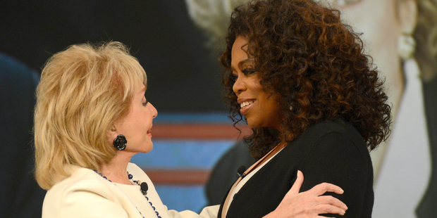 Oprah Winfrey embraces Barbara Walters during a taping of Walters' final co-host appearance on The View. AP Photo / ABC / Ida Mae Astute