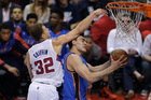 Los Angeles Clippers' Blake Griffin, left, fouls Oklahoma City Thunder's Steven Adams during the first half in Game 6 of the NBA Western Conference semi-finals. Photo / AP