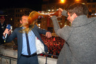 Television presenter Markus Othmer gets all his beer at once from soccer player Thomas Mueller on the balcony of the Munich town hall during celebrations for Bayern's Champion title. Photo / AP