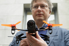 Parrot CEO Henri Seydoux holds a Parrot Bebop drone. The drone, which has a 14-megapixel camera and battery life of 12 minutes flying time, is scheduled to be released later this year. Photo / AP
