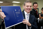 Finance Minister Bill English checking copies of his 2014 Budget as they roll off the press. Photo / Mark Mitchell