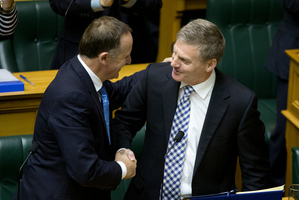 Finance Minister Bill English is congratulated by Prime Minister John Key after reading his 2014 Budget in Parliament, Wellington. Photo / Mark Mitchell