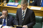 Finance Minister Bill English, with Prime Minister John Key, reading the 2013 Budget. File photo / Mark Mitchell