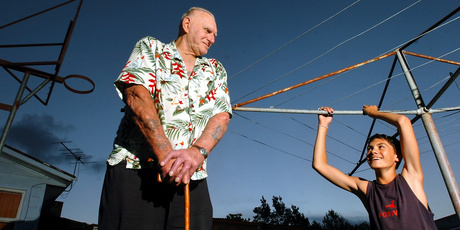Steven Adams hanging off the clothesline as a 12-year-old, with father Sid. Photo / Stephen Parker