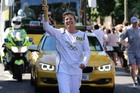 Olympic Gold medalist Barbara Kendall carries the Olympic Torch.