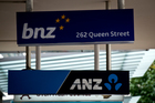 Bank signs along Queen Street in Auckland City. Photo / Dean Purcell.