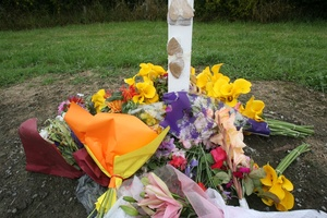 Flowers and messages left on Somerset Road near the scene of the fatal hot air balloon crash.