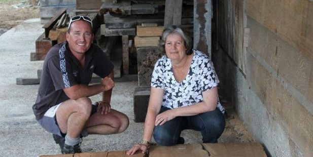 Todd Uttinger and Val Baker with the native totora timber carbon dated at nearly 5000 years old.