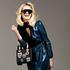 Prada leather and silk dress, $9900, & cashmere scarf $730. Christian Dior embroidered handbag $8200. Oakley  sunglasses $300. Columbine hoisery, $29, from Farmers.