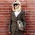 Lanvin jacket, $3900, & skirt, $1950, from Scotties. Standard Issue blouse $348. Oakley sunglasses $300. Stella McCartney faux leather handbag, $1390, from Runway. Picture / Mara Sommer