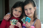 Twins Jesse and Hannah Shaw with their Countdown DreamWorks collectable cards. Photo / Doug Sherring