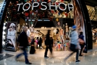 Shoppers look for the latest fashion bargains at a Topshop store in Stratford, London.