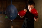 Jess Koia gives the Kawerau Boxing Club punchbag a hammering. Photo / Alan Gibson