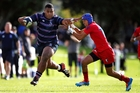 Taniela Tupou, a gifted Sacred Heart College front-row forward, fends off Troy Siemsen of Kelston Boys