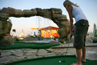 The greatest putt-putt shot of all time. A water fountain floating golf ball to hole-in-one. Photo / Thinkstock.