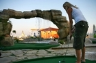 The greatest putt-putt shot of all time. A water fountain floating golf ball to hole-in-one. Video / Kyle Cox