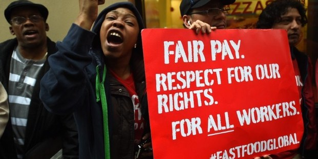 Fast-food workers around the world this month staged a global protest to demand an increase of their minimum wage. Photo / AFP