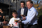 rime Minister John Key hands out free sausages yesterday with Cody Campbell (9), of Queenstown, and Clutha-Southland National Party candidate Todd Barclay. Photo / Tracey Roxburgh
