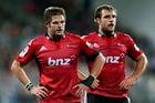 Richie McCaw and Luke Whitelock wonder what went wrong after the Sharks beat them at home with 14, and at one stage 13, men. Photo / Getty Images
