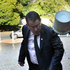 John Banks is attacked with a bucket of mud, as he arrives at the High Court in Auckland this morning. Photo / Brett Phibbs