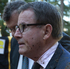 John Banks after he was attacked with a bucket of mud, as he arrives at the High Court in Auckland this morning. Photo / Brett Phibbs