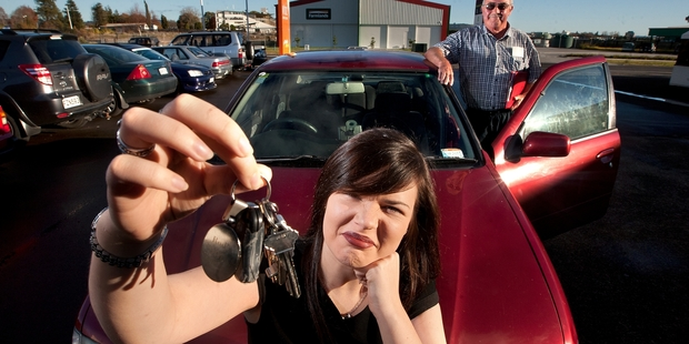 SHOCKED: Even though she passed the harder restricted driving test in Auckland, reporter Stephanie Arthur-Worsop failed a mock assessment in Rotorua. She is pictured with instructor Allan Koller. PHOTO/BEN FRASER 220514BF10