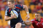 Rebels fly-half Bryce Hegarty attempts to evade Will Genia. Photo / Getty Images.