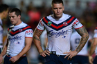 Roosters players leave the field dejected after being dominated by the Cowboys. Photo / Getty Images.