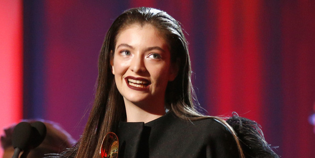 Lorde accepts the award for Top New Artist at the 2014 Billboard Music Awards. Photo/Getty.