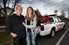 Brett and Maria Sutherland with their son's Ducati at the site of his crash. Photo / Doug Sherring