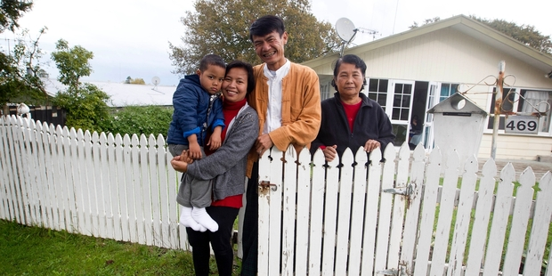 Ye Tun Oo, centre, with his son, wife and mother-in-law. Photo / NZ Herald