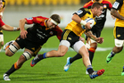 TJ Perenara of the Hurricanes is tackled by Michael Fitzgerald of the Chiefs during the round 15 Super Rugby match between the Hurricanes and the Chiefs. Photo / Getty Images.