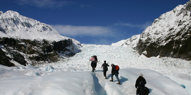 Visitors to South Westland hike up Fox Glacier. Photo / Thinkstock