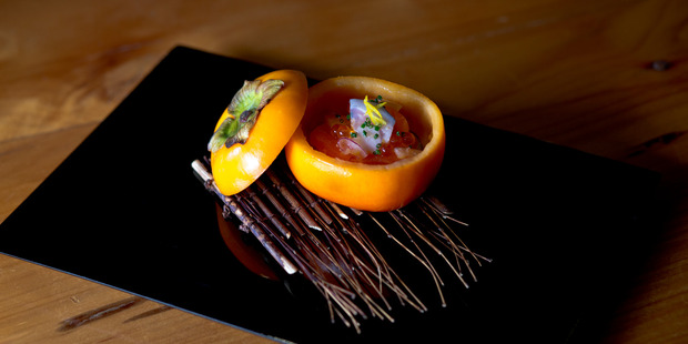 Salmon served in a scooped-out persimmon shell at Cocoro. Photo / Dean Purcell