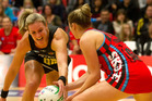 Magic player, Leanna de Bruin, fights for the ball with Tactix player, Anna Thompson. Photo / Alan Gibson