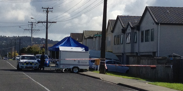 Police attend to the scene at a house in Pooks Rd Ranui where the bodies of two deceased women were found. Photo / Brett Phibbs