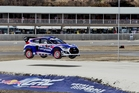 New Zealand's Emma Gilmour flies over a jump in her Rhys Millen Racing Hyundai Veloster Turbo at the Red Bull Global Rallycross Championship's (GRC) first round in Barbados. Picture / Nigel Brown