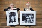 The Day sisters, Charlotte, 13 (left) and Jess, 14, with two of the images snapped by grandfather Mike Randolph. Photo / Richard Robinson