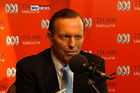 Tony Abbott winks during a radio phone-in yesterday.