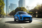 Porsche's Macan compact SUV. Porsche has had to explain to US dealers that using Tigers in promoting the Macan is a bad idea. We wonder why...