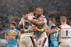 Ben Matulino (L) of the Warriors celebrates with Manu Vatuvei after scoring a try during the round 11 NRL match between the Gold Coast Titans and the NZ Warriors. Photo / Getty.