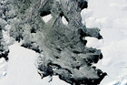 A large iceberg separating from the Pine Island Glacier and traveling across Pine Island Bay in Antarctica. Photo / AP