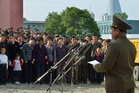 A North Korean official, right, apologises in front of families of victims of an accident at an apartment construction in Pyongyang. Photo / AP