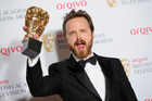 U.S actor Aaron Paul gestures with his Bafta International award at the British Academy Television Awards. Photo / AP