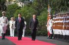 Russia's President Vladimir Putin, centre right, and China's President Xi Jinping, centre left, walk to open joint naval exercises, in Shanghai, China. Photo / AP