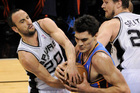 San Antonio Spurs guard Manu Ginobili, left, of Argentina, fights for possession with Oklahoma City Thunder center Steven Adams. Photo / AP