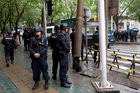 Armed policemen stand guard near the site of an explosion in Urumqi, northwest China's Xinjiang region. Photo / AP