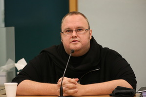 Kim Dotcom gives evidence in the witness stand at the High Court in Auckland. Photo / Greg Bowker