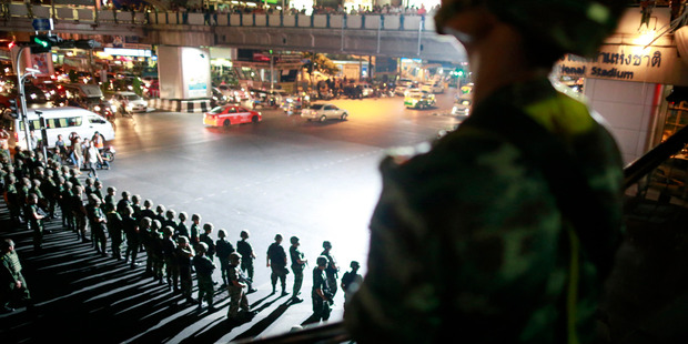 Thai soldiers secure the intersection to prevent pro-government protesters to gather to protest against the coup in downtown Bangkok. Photo / AP