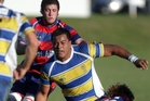 Clive captain and hooker Jorian Tangaere unloads as Central locks Lance Baker, left, and Hugh Graham apply defensive pressure during his team's 30-25 win on Saturday. Photo/Paul Taylor